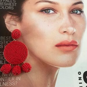 Red beads statement earrings.